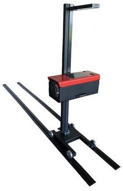 Dispositivo de ajuste de los faros montados sobre rieles